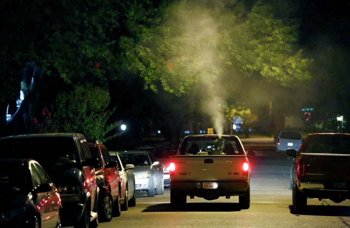 A neighborhood in North Dallas is sprayed for mosquitoes that carry the West Nile virus by a city of Dallas truck. Experts say the number of cases in Texas should continue to increase over the next few weeks.