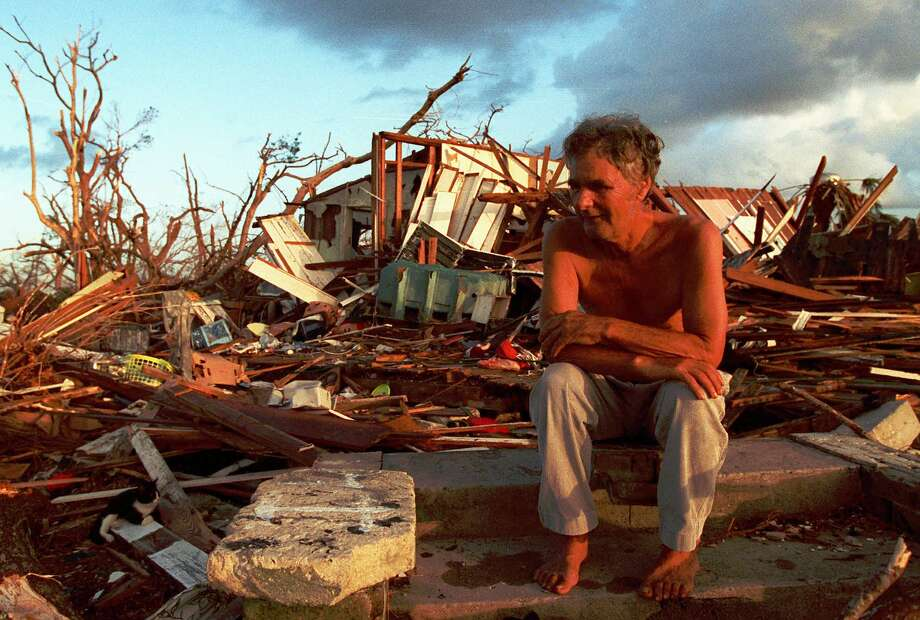A Florida City, Fla., man sits in the debris that was once his house after Hurricane Andrew in 1992. Photo: LYNN SLADKY / AP