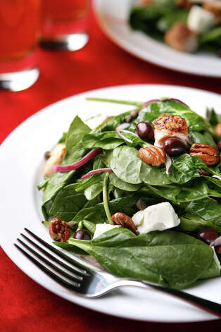 Top your salad with olive, walnut, macademia or canola oil to boost absorption of carotenoids. Photo: Liz O. Baylen, Los Angeles Times / LOS ANGELES TIMES