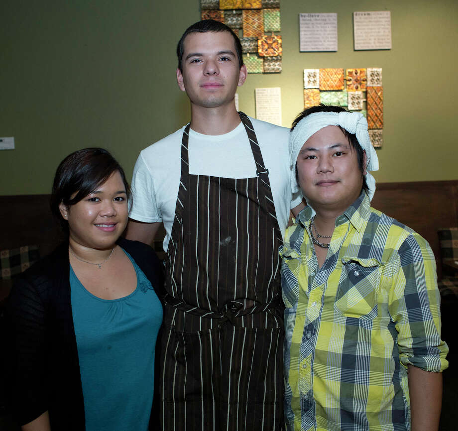 Server Merce Doria (from left), kitchen manager Ethan Hernandez and owner  Jet Vong get together during the seven-year anniversary celebration of  Thai Pikul Restaurant. Photo: J. Michael Short, For The Express-News / THE SAN ANTONIO EXPRESS-NEWS