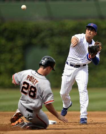 Chicago Cubs second baseman Darwin Barney, right, throws to first after forcing out San Francisco Giants' Buster Posey at second when Hunter Pence grounded into a double play in the second inning during a baseball game in Chicago, Friday, Aug. 31, 2012. Chicago won 6-4. (AP Photo/Paul Beaty) Photo: Paul Beaty, Associated Press