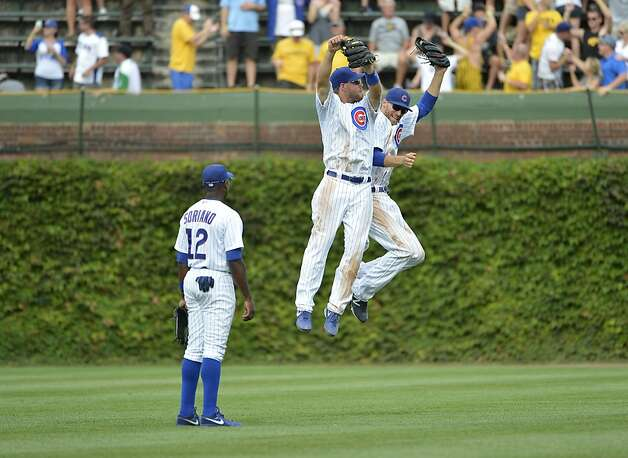 Center fielder Brett Jackson #7 and right fielder Joe Mather #21 celebrate a win over the San Francisco Giants as left fielder Alfonso Soriano #12 watches at Wrigley Field on August 31, 2012 in Chicago, Illinois. The Cubs defeated the Giants 6-4.  (Photo by Brian Kersey/Getty Images) Photo: Brian Kersey, Getty Images