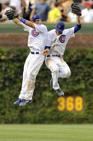 Chicago Cubs outfielders Brett Jackson left, and Joe Mather, right, celebrate after defeating the San Francisco Giants 6-4 in a baseball game in Chicago, Friday, Aug. 31, 2012. (AP Photo/Paul Beaty) Photo: Paul Beaty, Associated Press