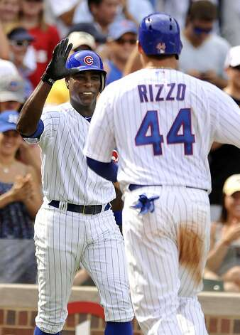 Chicago Cubs' Alfonso Soriano, left, celebrates with teammate Anthony Rizzo (44) after Rizzo hit a solo home run in the fifth inning during a baseball game against the San Francisco Giants in Chicago, Friday, Aug. 31, 2012. Chicago won 6-4. (AP Photo/Paul Beaty) Photo: Paul Beaty, Associated Press