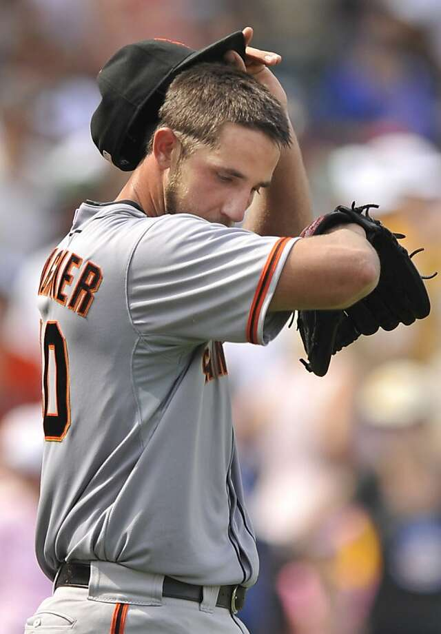 San Francisco starting pitcher Madison Bumgarner wipes his face after giving up four runs to the Chicago Cubs in the third inning during a baseball game in Chicago, Friday, Aug. 31, 2012. (AP Photo/Paul Beaty) Photo: Paul Beaty, Associated Press
