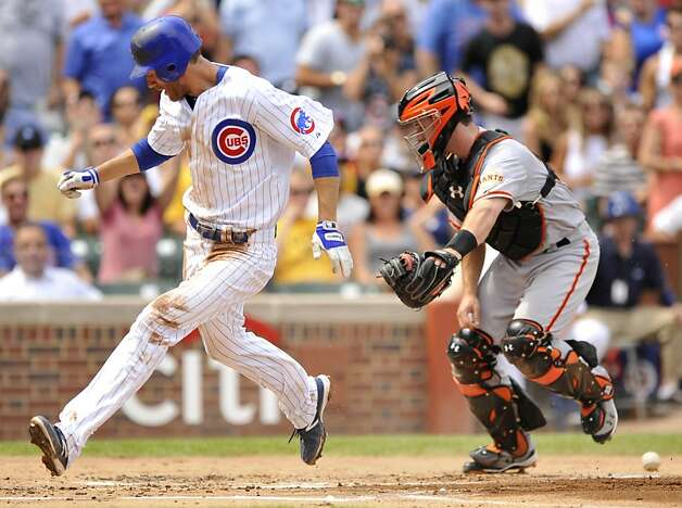 Chicago Cubs' Joe Mather left, crosses home plate safely on a Alfonso Soriano single as San Francisco catcher Buster Posey tries to hold on the the ball in the first inning during a baseball game in Chicago, Friday, Aug. 31, 2012. (AP Photo/Paul Beaty) Photo: Paul Beaty, Associated Press