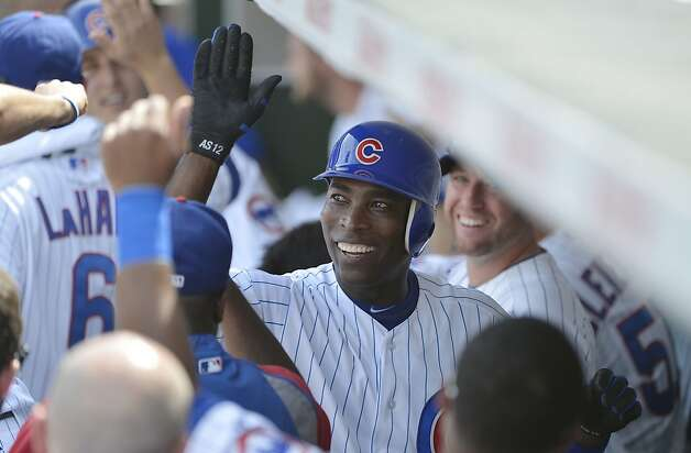 Alfonso Soriano #12 of the Chicago Cubs is congratulated in the dugout after hitting a two-run home run scoring teammate Anthony Rizzo #44 during the third inning against the San Francisco Giants at Wrigley Field on August 31, 2012 in Chicago, Illinois.  (Photo by Brian Kersey/Getty Images) Photo: Brian Kersey, Getty Images