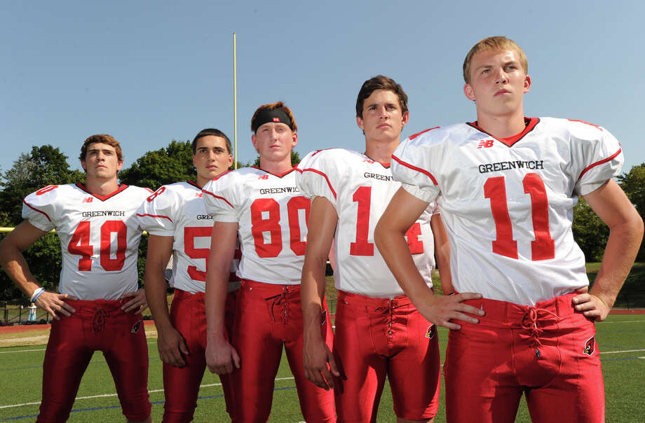 Greenwich High School football captains from left, Taylor Olmstead, Alex McGee, Joe Kelly, Liam O'Neil and Alex McMurray, during photo day for the Greenwich High School football team at the school, Friday, Aug. 31, 2012. Photo: Bob Luckey / Greenwich Time