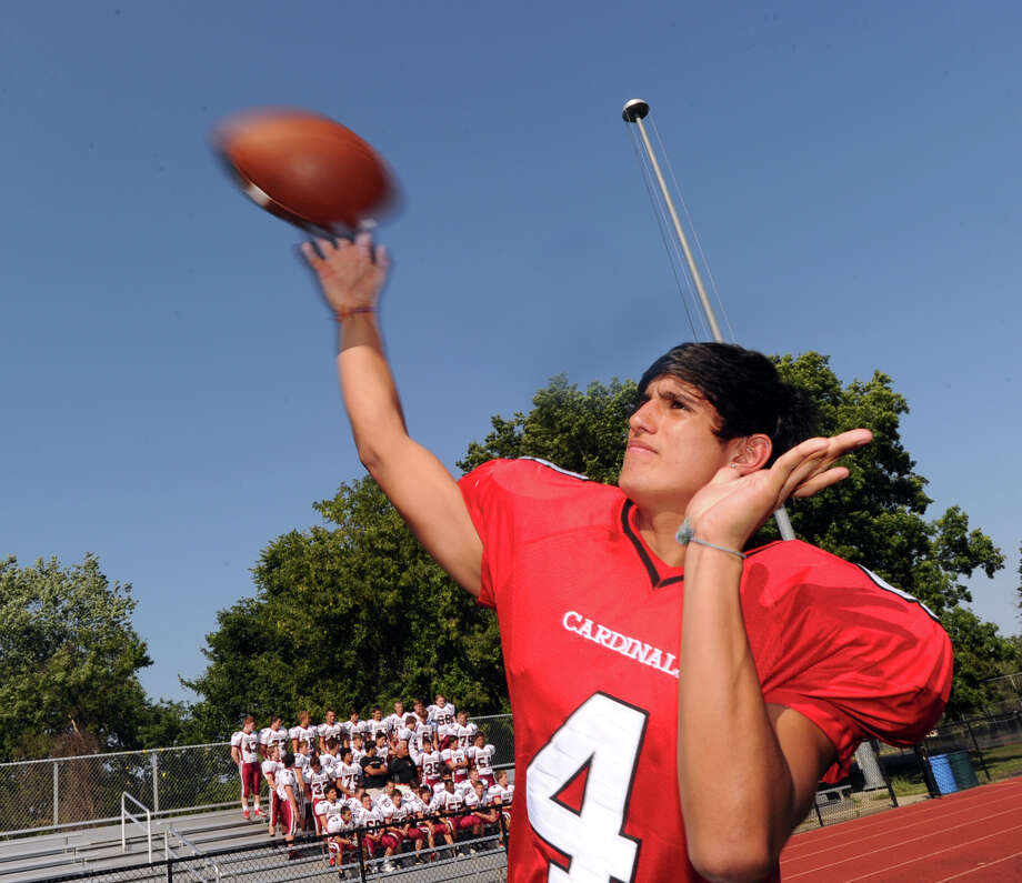 Greenwich High School football player Jose Melo, a quarterback and receiver, throws during photo day for the Greenwich High School football team at the school, Friday, Aug. 31, 2012. Photo: Bob Luckey / Greenwich Time