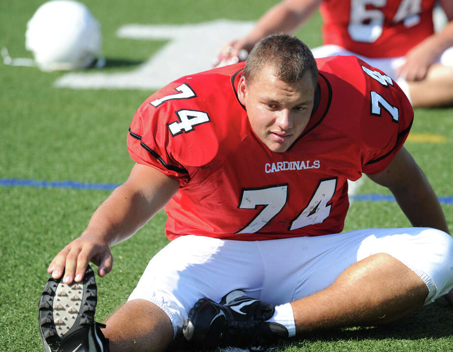 Greenwich High School football player NIck Spano, # 74, an offensive tackle, stretches during photo day for the Greenwich High School football team at the school, Friday, Aug. 31, 2012. Photo: Bob Luckey / Greenwich Time