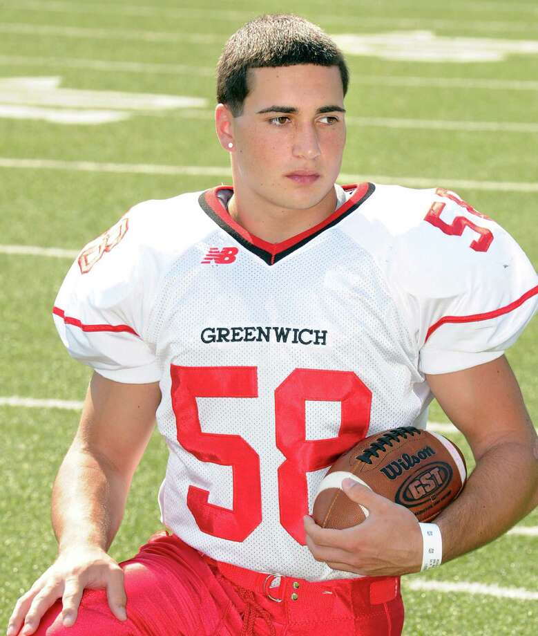 Greenwich High School football captain, Alex McGee, a defensive end, during photo day for the Greenwich High School football team at the school, Friday, Aug. 31, 2012. Photo: Bob Luckey / Greenwich Time