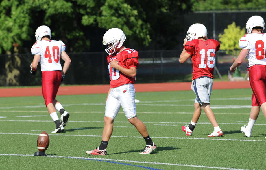 Greenwich High School kicker Jesse Adelberg, # 10, prepares to kick-off during photo day for the Greenwich High School football team at the school, Friday, Aug. 31, 2012. Photo: Bob Luckey / Greenwich Time