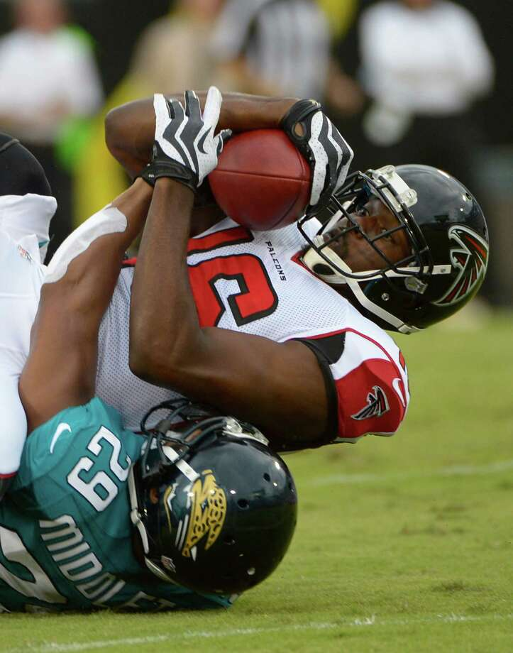 Atlanta Falcons wide receiver Marcus Jackson, top, hangs on to the ball after a reception as he is tackled by Jacksonville Jaguars cornerback William Middleton (29) during the first half of an NFL preseason football game on Thursday, Aug. 30, 2012, in Jacksonville, Fla. (AP Photo/Phelan M. Ebenhack) Photo: Phelan M. Ebenhack, FRE / AP2012