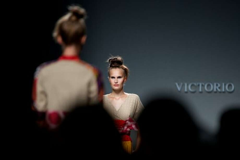 Models walk the runway in the Victorio & Lucchino fashion show. (Getty Images)