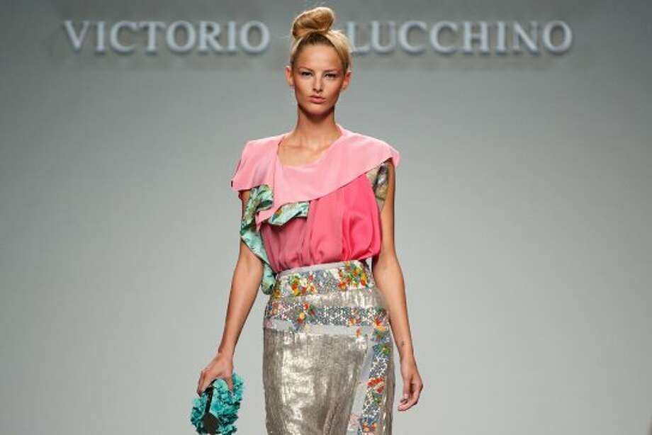 A model walks the runway in the Victorio & Lucchino fashion show. (Getty Images)