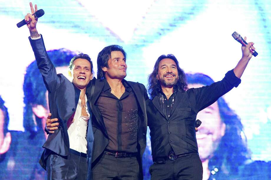 Singers Marc Anthony, left to right, Chayanne and Marco Antonio Solis perform in concert during their Gigantes Tour on Friday, August 10, 2012 in East Rutherford, NJ. Photo: Charles Sykes, . / Invision