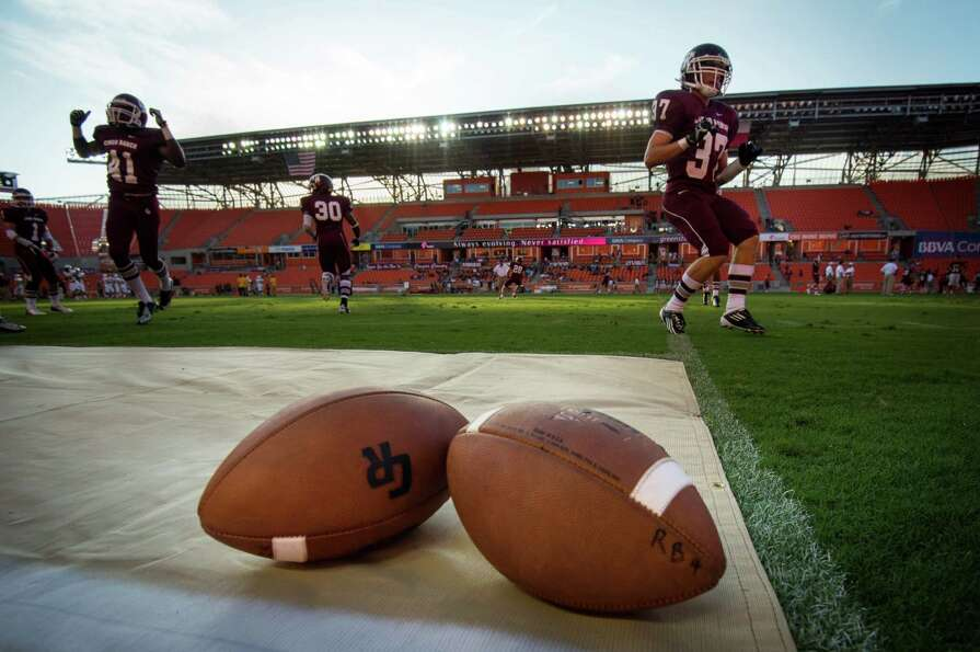 Cinco Ranch players warm up before a high school football game against Cy Ranch at BBVA Compass Stad