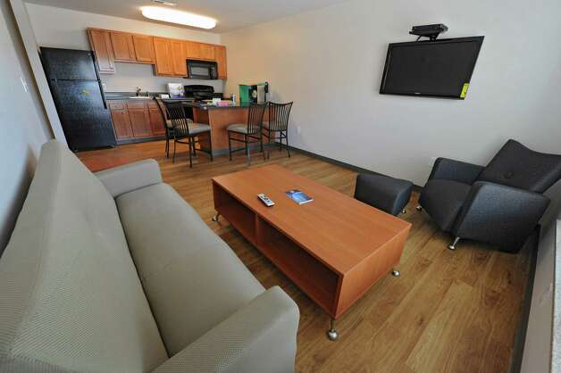 The living room in one of the suites in the brand new College Suites at Washington Square Friday, Aug. 31, 2012 in Schenectady, N.Y. Schenectady County Community College (SCCC) students move in today. (Lori Van Buren / Times Union) Photo: Lori Van Buren