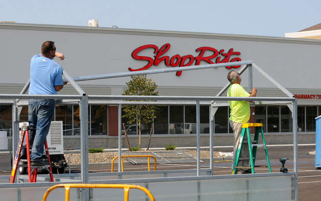 Construction workers build a shopping cart corral in the parking lot of the ShopRite in the new Vista Tech Park Thursday, Aug. 30, 2012 in Bethlehem, N.Y. (Lori Van Buren / Times Union) Photo: Lori Van Buren