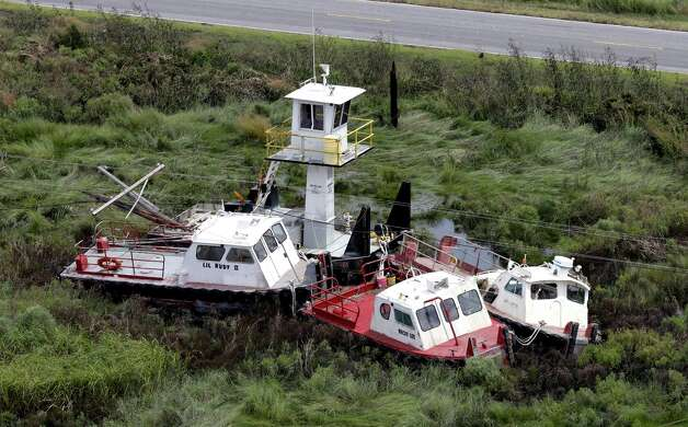 Boats are tangled in power lines in the aftermath of Isaac in Yscloskey, La., Friday, Aug. 31, 2012. Isaac is now a tropical depression, with the center on track to cross Arkansas on Friday and southern Missouri on Friday night, spreading rain through the regions. Photo: David J. Phillip, Associated Press / AP