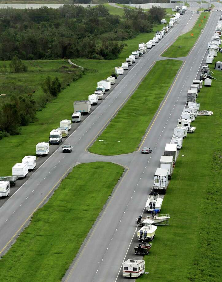 Campers and boats line the road leading into Verret, La., in the aftermath of Isaac Friday, Aug. 31, 2012. Isaac is now a tropical depression, with the center on track to cross Arkansas on Friday and southern Missouri on Friday night, spreading rain through the regions. Photo: David J. Phillip, Associated Press / AP
