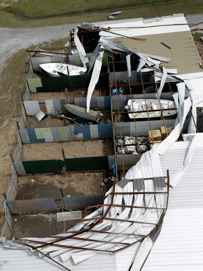 Boats sit in a damage storage building in Reggio, La., in the aftermath of Isaac Friday, Aug. 31, 2012. Isaac is now a tropical depression, with the center on track to cross Arkansas on Friday and southern Missouri on Friday night, spreading rain through the regions. Photo: David J. Phillip, Associated Press / AP