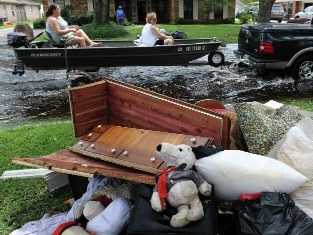 Residents of the River Forest subdivision in LaPlace, La., start cleaning up Friday Aug. 31, 2012, after flooding caused by Hurricane Isaac. Photo: Arthur D. Lauck, Associated Press / The Advocate