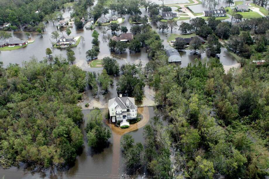 Homes are surrounded by floodwaters from Isaac , in Lafitte, La., Friday, Aug. 31, 2012. Isaac is now a tropical depression, with the center on track to cross Arkansas on Friday and southern Missouri on Friday night, spreading rain through the regions. Photo: Gerald Herbert, Associated Press / AP