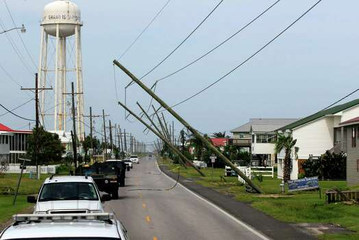 Utility poles are heavily damaged in the aftermath of Isaac as Louisiana Gov. Bobby Jindal's motorcade passes through Grad Isle, La., Friday, Aug. 31, 2012. Isaac is now a tropical depression, with the center on track to cross Arkansas on Friday and southern Missouri on Friday night, spreading rain through the regions. Photo: Gerald Herbert, Associated Press / AP