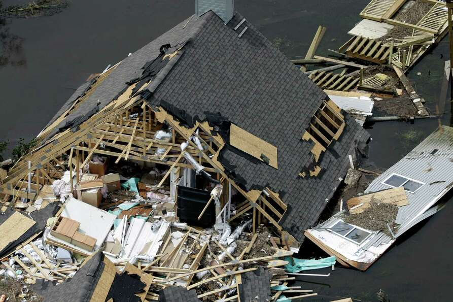 This aerial photo shows a home destroyed by Isaac in Yscloskey, La., Friday, Aug. 31, 2012. Isaac is
