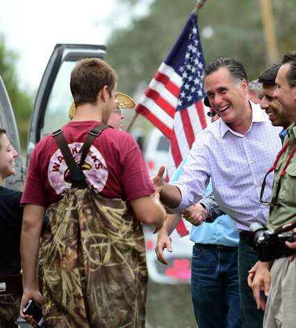 Republican White House hopeful Mitt Romney meets with storm-affected residents from Hurricane Isaac in LaFitte, outside of New Orleans, on August 31, 2012 in Louisiana.  Romney, who became his party's official presidential nominee a night earlier, beat US President Barack Obama to the storm zone in Louisiana, where he also met Governor Bobby Jindal and first responders in the town of LaFitte. Photo: FREDERIC J. BROWN, AFP/Getty Images / AFP