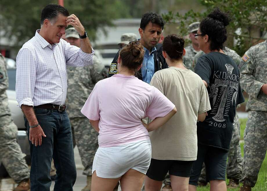 Republican presidential candidate, former Massachusetts Gov. Mitt Romney (L) and Louisiana Gov. Bobby Jindahl talk with victims of Hurricane Isaac on August 31, 2012 in Lafitte, Louisiana.  Days after Hurricane Isaac pounded Louisiana, Mitt Romney visited the state to view a neighborhood devastated by the storm. Photo: Justin Sullivan, Getty Images / 2012 Getty Images