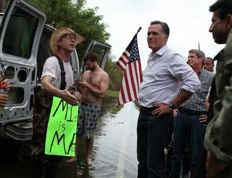 Republican presidential candidate, former Massachusetts Gov. Mitt Romney (R) talks with a man on the side of the road while touring a hurricane damaged neighorhood on August 31, 2012 in Lafitte, Louisiana.  Days after Hurricane Isaac pounded Louisiana, Mitt Romney visited the state to view a neighborhood devastated by the storm. Photo: Justin Sullivan, Getty Images / 2012 Getty Images