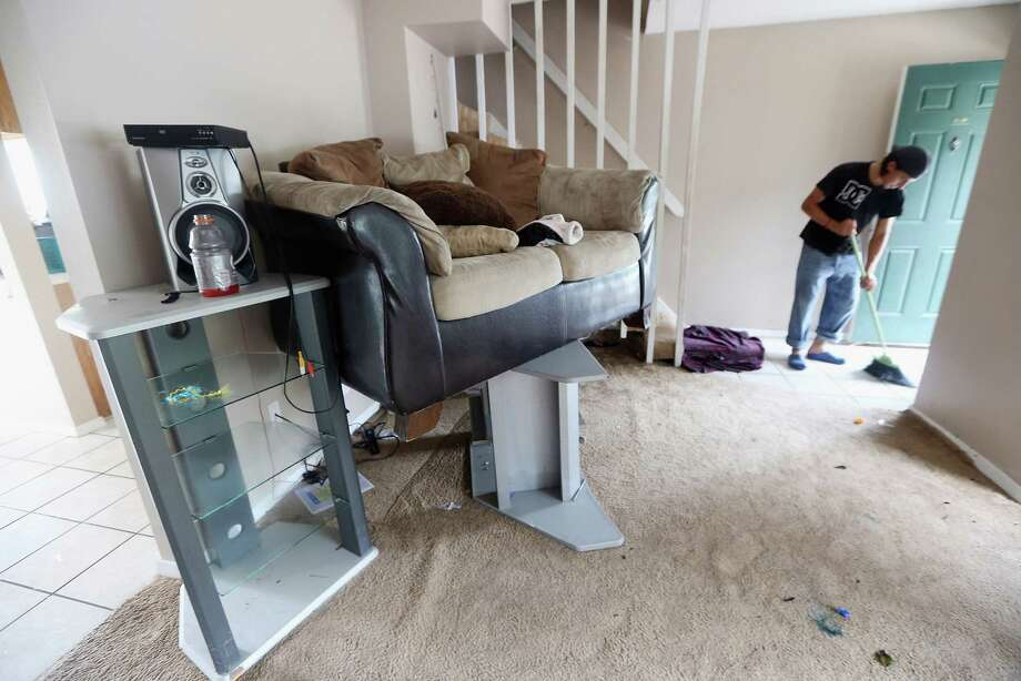 A resident cleans his apartment which flooded and doesn't have electricity on August 31, 2012 in Slidell, Louisiana. Louisiana residents are coping with the aftermath of Hurricane Isaac with ongoing flooding, destroyed property and many still without electricity. Photo: Mario Tama, Getty Images / 2012 Getty Images