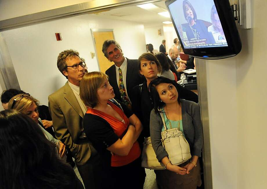 Amanda Wallner (center in orange) and Annie Pham (right) of Sierra Club California watch Assembly proceedings in Sacramento on August 31, 2012. The Legislature met for its final day of the two-year legislative session. Photo: Susana Bates, Special To The Chronicle