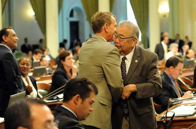 Assembly Member Bob Wieckowski (left) congratulates fellow member Warren Furutani after passing the Pension bill in Sacramento on August 31, 2012. The Legislature met for its final day of the two-year legislative session. Photo: Susana Bates, Special To The Chronicle