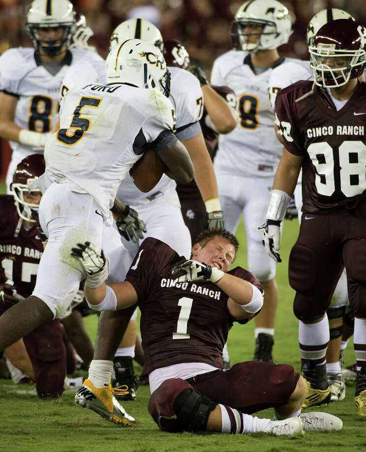 Cy Ranch running back Keith Ford (5) tussles with Cinco Ranch defensive back Ben Boyett after the whistle during the second quarter a high school football game at BBVA Compass Stadium, Friday, Aug. 31, 2012, in Houston. Photo: Smiley N. Pool, Houston Chronicle / © 2012  Houston Chronicle