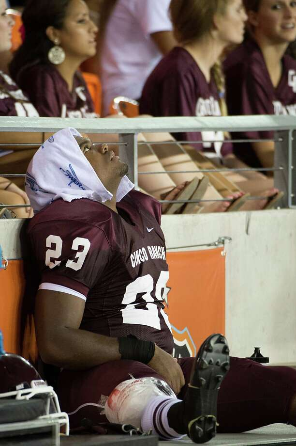 Cinco Ranch running back Jamel James sits on the sidelines after injuring his right knee during the first half of a high school football game against Cy Ranch at BBVA Compass Stadium, Friday, Aug. 31, 2012, in Houston. Photo: Smiley N. Pool, Houston Chronicle / © 2012  Houston Chronicle