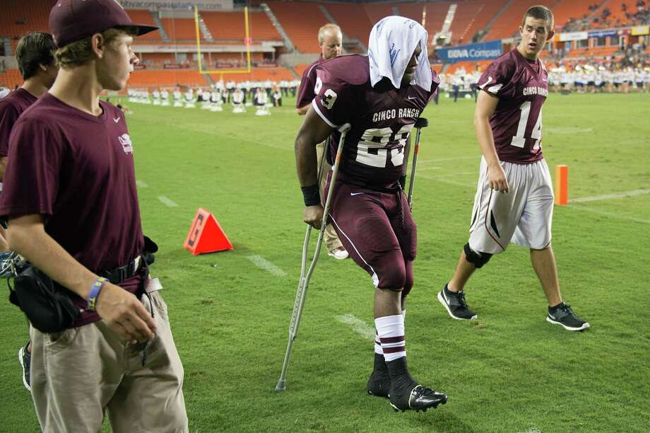 Cinco Ranch running back Jamel James leaves the field on crutches after injuring his right knee during the first half of a high school football game against Cy Ranch at BBVA Compass Stadium, Friday, Aug. 31, 2012, in Houston. Photo: Smiley N. Pool, Houston Chronicle / © 2012  Houston Chronicle