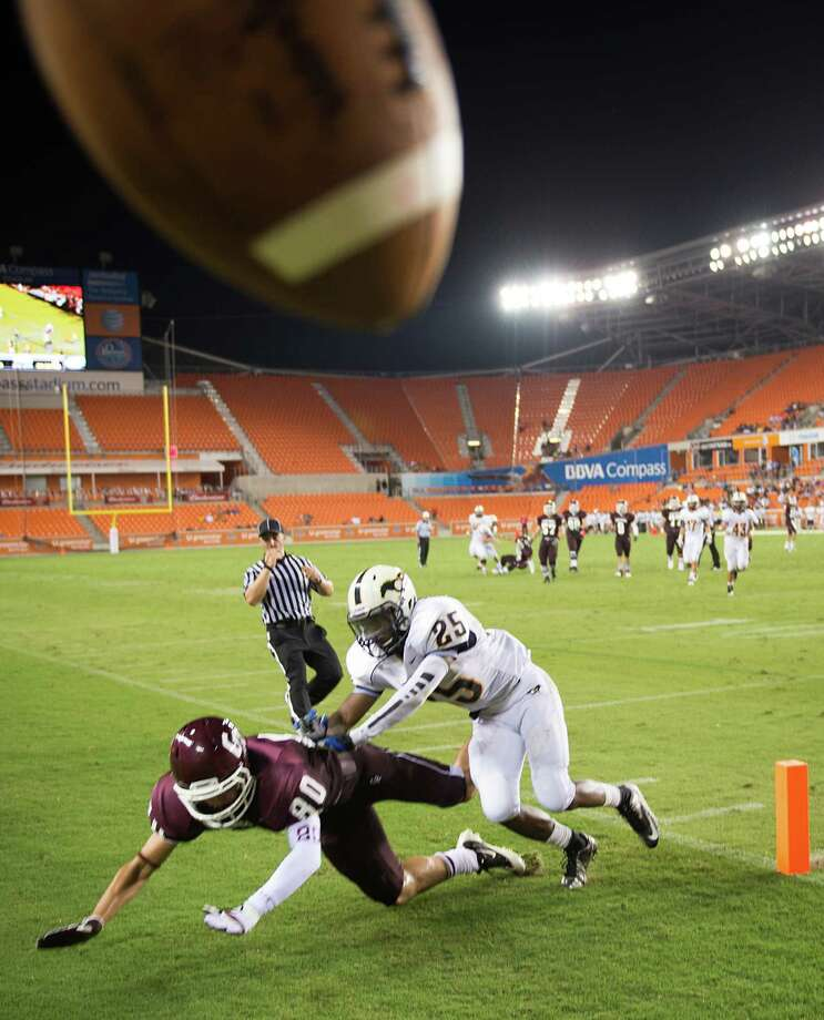 The ball goes sailing out of bounds as Cinco Ranch receiver Gabriel Sobarzo (80) can't come up with a pass as Cy Ranch defensive back Jacoby Gaylor (25) defends during the second quarter a high school football game at BBVA Compass Stadium,Friday, Aug. 31, 2012, in Houston Photo: Smiley N. Pool, Houston Chronicle / © 2012  Houston Chronicle