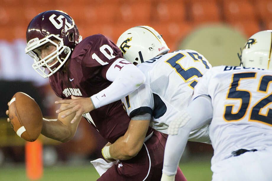 Cinco Ranch quarterback Cole Thomas (10) is sacked by Cy Ranch lineman Ryan Deculus during the first quarter of a high school football game at BBVA Compass Stadium, Friday, Aug. 31, 2012, in Houston. Photo: Smiley N. Pool, Houston Chronicle / © 2012  Houston Chronicle