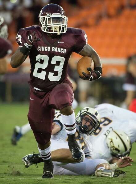 Cinco Ranch running back Jamel James (23) breaks a Cy Ranch tackle on his way to the first touchdown