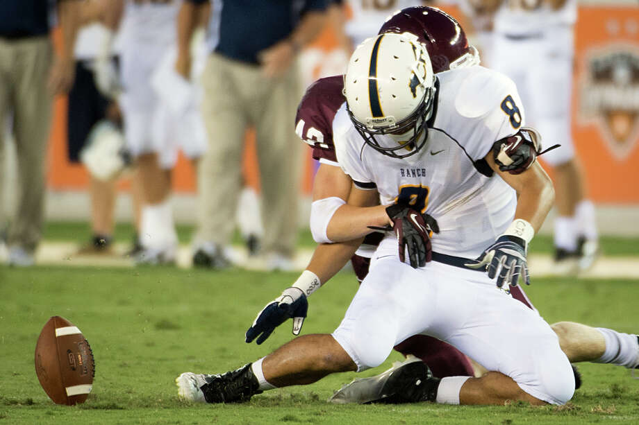 Cinco Ranch defensive back Kevin Colpoys (42) forces a fumble by Cy Ranch tight end Hunter Kliafas (8) during the first quarter of a high school football game at BBVA Compass Stadium, Friday, Aug. 31, 2012, in Houston. Photo: Smiley N. Pool, Houston Chronicle / © 2012  Houston Chronicle