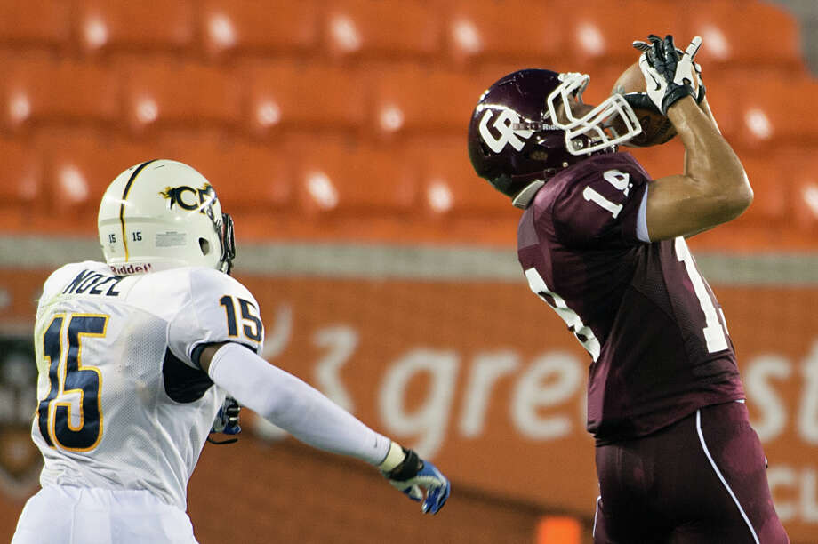 Cinco Ranch wide receiver Ethan Baxter makes a catch as Cy Ranch defensive back Randy Noel defends during the first quarter of a high school football game at BBVA Compass Stadium, Friday, Aug. 31, 2012, in Houston. Photo: Smiley N. Pool, Houston Chronicle / © 2012  Houston Chronicle