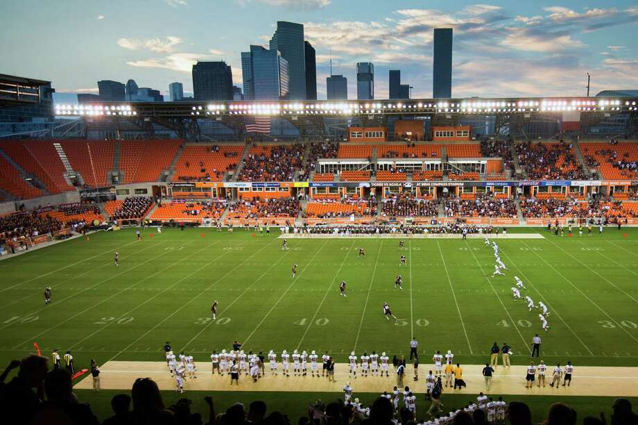 Against the backdrop of the downtown Houston skyline, Cy Ranch kicks off to Cinco Ranch in the first game of the season during the inaugural high school football game at BBVA Compass Stadium, Friday, Aug. 31, 2012, in Houston. Photo: Smiley N. Pool, Houston Chronicle / © 2012  Houston Chronicle