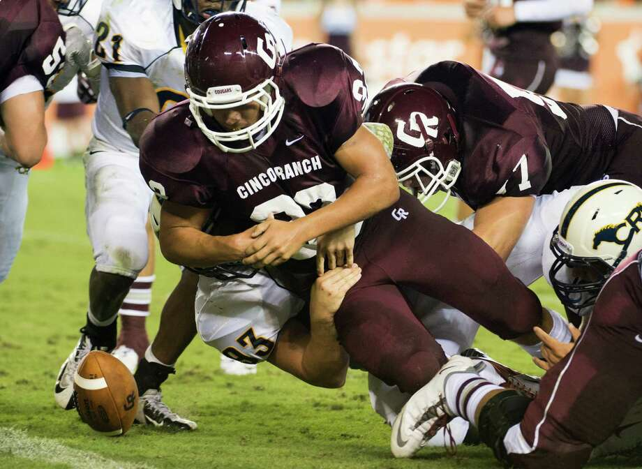 Cinco Ranch running back Blake Hirsch fumbles at the goal line to turn the ball over to Cy Ranch during the second quarter a high school football game at BBVA Compass Stadium, Friday, Aug. 31, 2012, in Houston. Photo: Smiley N. Pool, Houston Chronicle / © 2012  Houston Chronicle