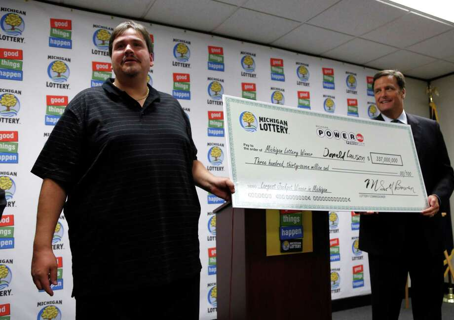12. $337.0 million, Powerball, Aug. 15, 2012 (1 ticket from Michigan)Donald Lawson, left, a 44-year-old Lapeer, Mich. resident, holds his ceremonial check with Michigan Lottery Commissioner M. Scott Bowen at a news conference in which he claimed the Powerball prize Friday, Aug. 31, 2012, at the Michigan Lottery headquarters in Lansing, Mich. Lawson elected the lump sum option of $224.6 million before state and federal taxes. Photo: Al Goldis / FR11125 AP