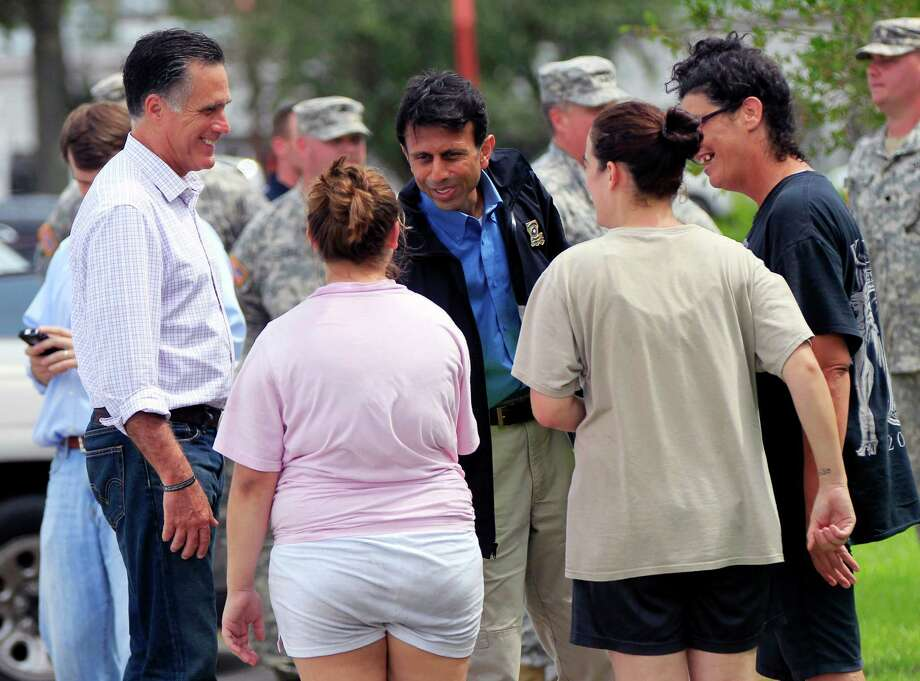 Republican presidential candidate Mitt Romney left, and Louisiana Gov. Bobby Jindal, center, greet residents displaced by Isaac in Lafitte, La., Friday, Aug. 31, 2012. Isaac is now a tropical depression, with the center on track to cross Arkansas on Friday and southern Missouri on Friday night, spreading rain through the regions. (AP Photo/Gerald Herbert) Photo: Gerald Herbert