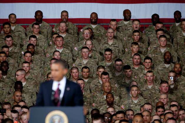 Soldiers listen to President Barack Obama as he address them at Fort Bliss Military Instillation on Friday August 31, 2012. The President met privately with service members and their families and to highlight the second anniversary of the end of combat operations in Iraq. Photo by Ivan Pierre Aguirre Photo: Ivan Pierre Aguirre, San Antonio Express-News / Ivan Pierre Aguirre