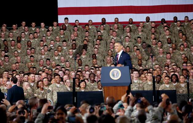 Soldiers and President Barack Obama laugh as he addresses them at Fort Bliss Military Installation on August 31, 2012. The president met privately with service members and their families and 